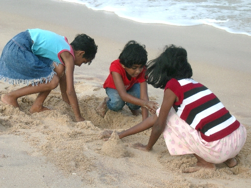 tsunami-survivor-children-return-to-the-sea-in-suduwella-southern-sri-lanka.jpg
