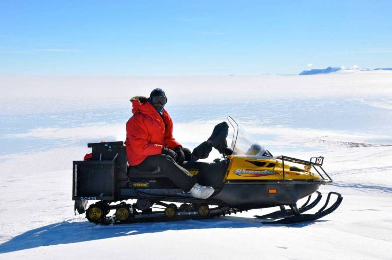 Dr Ray Jayawardhana in Antarctica on snowmobile