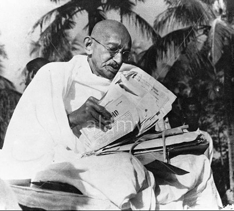Gandhi reading newspaper in 1947