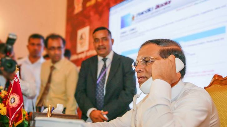 President Maithripala Sirisena (seated) launched Tell the President service on 8 January 2016 - Photo by Presidential Media Division